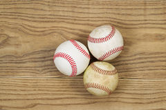 Used Baseballs on Aged Wood Royalty Free Stock Photos