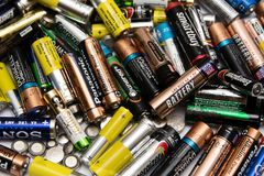 Used batteries from different manufacturers. Yoshkar-Ola, RUSSIA - SEPTEMBER, 2018 Used batteries from different manufacturers, waste, collection and recycling royalty free stock photos