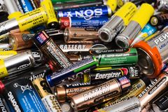 Used batteries from different manufacturers. Yoshkar-Ola, RUSSIA - SEPTEMBER, 2018 Used batteries from different manufacturers, waste, collection and recycling royalty free stock images