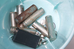 The used batteries lie in a special plastic container. Stock Photo