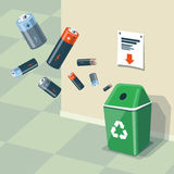 Used Batteries Recycling Bin Trash. Illustration of used batteries and recycling bin for them. Batteries are in the air and falling into the green trash bin Royalty Free Stock Images