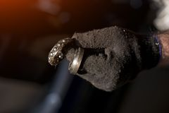 Used bearing in mechanic`s hand stock image