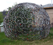 Used bicycle tires forming a globe-like sculpture Royalty Free Stock Photos