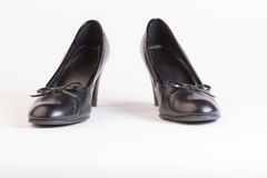 Used black heels on white Stock Image