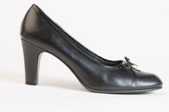Used Black high heel shoe on white Stock Image