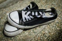 Used black sneakers Stock Photos