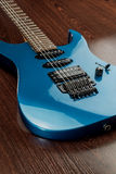 Used blue guitar vertical Royalty Free Stock Images