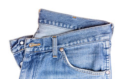 Used blue jeans isolated on white background. Close up of used blue jeans isolated on white background stock photo