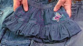 Used blue jeans and skirts for sale. Second hand stock video