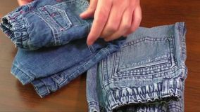 Used blue jeans and skirts for sale stock video footage
