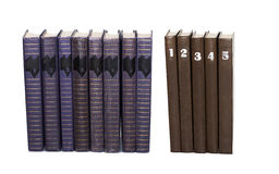 Used books volumes with numbers on covers. Eight turquoise color, five brown cover book collection. White background Stock Photo