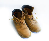 Used boots. A pair of used boots over a white background Royalty Free Stock Images