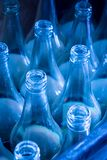 Used bottles waiting for reuse. Close up used blue empty glass bottles waiting for reuse Stock Image