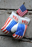 Used Boxing Gloves and US Flag Stock Image