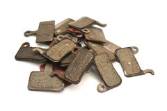 Used brake pads. A heap of used bicycle brake pads isolated on white Stock Photo