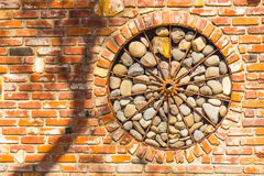 Used Brick Wheel With River Rock Behind Spokes Stock Image