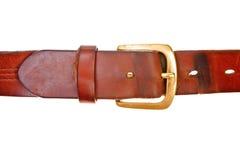 Used broun leather belt. Isolated on white background stock image