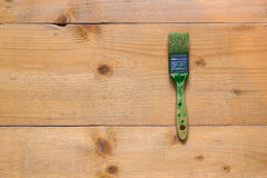 Used brush on raw wood board surface. Flat view from top Royalty Free Stock Image