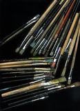 Used brushes. Many used and dirty brushes on black background Stock Images