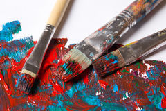 Used brushes and paint background with blue and red strokes Stock Photo