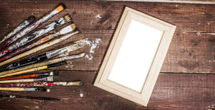 Used  brushes and photo frame Royalty Free Stock Photo