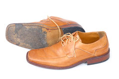 Used Businessmen Shoes. Pair of used brown male shoes over white Royalty Free Stock Image