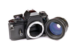 Used camera body and lens. Isolated on white background Royalty Free Stock Images