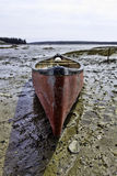 Used canoe at low tide Royalty Free Stock Images