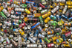 Used cans in metal crate Stock Images