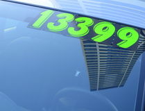 Used Car. Retail Business Image of A Price Sticker On A Used Car stock photography