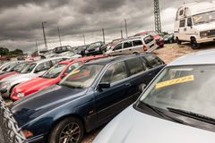 Used car dealer. Lots of used cars at a dealer with crazy clouds for your copy stock image
