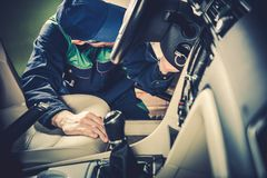 Used Car Maintenance. Auto Service Technician Checking Vehicle Interior Looking For Issues royalty free stock photo