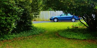 Used car parked in yard Royalty Free Stock Image