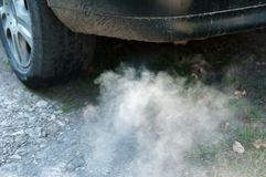 Used car polluting . Royalty Free Stock Images