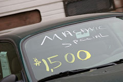 Used car sales. Used car advertised as macanic special. only $1500, what a bargain Royalty Free Stock Images