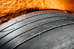 Used car tire with worn-out depth of thread Stock Photos