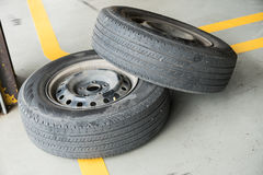 Used car tires pile in the tire repair shop yard.  royalty free stock photography