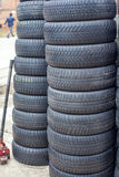 Used car tires pile in the tire repair shop yard Royalty Free Stock Photos