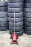 Used car tires pile in the tire repair shop yard.  stock image