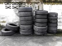 Used car tires pile in the tire repair shop yard. For design royalty free stock photo