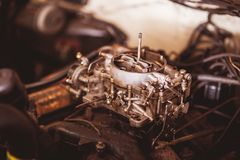Used carburetor from the fuel supply system of gasoline engine Royalty Free Stock Photography