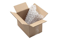 Used cardboard box and bubble wrap. Open used carton with bubble wrap isolated on white royalty free stock photography