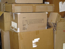 Used Cardboard Boxes. A stack of various size emptied cardboard delivery boxes stock photos