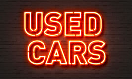 Used cars neon sign. On brick wall background Stock Photos