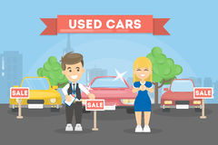 Used cars store. Woman wants to buy the car Royalty Free Stock Photography
