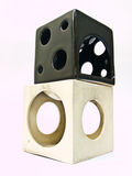 A couple of used white and black cube ceramic aroma burners Stock Image