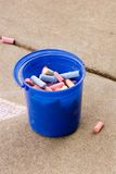 Used chalk in a pail. Chalk pieces in a pail Royalty Free Stock Photos