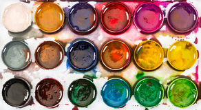 Used children`s honey watercolor paints . Top view. Stock Photo