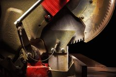 Circular Saw Details. Used circular saw on black background, closeup of details Royalty Free Stock Photo
