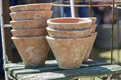 Used clay pots on an old chair Royalty Free Stock Image